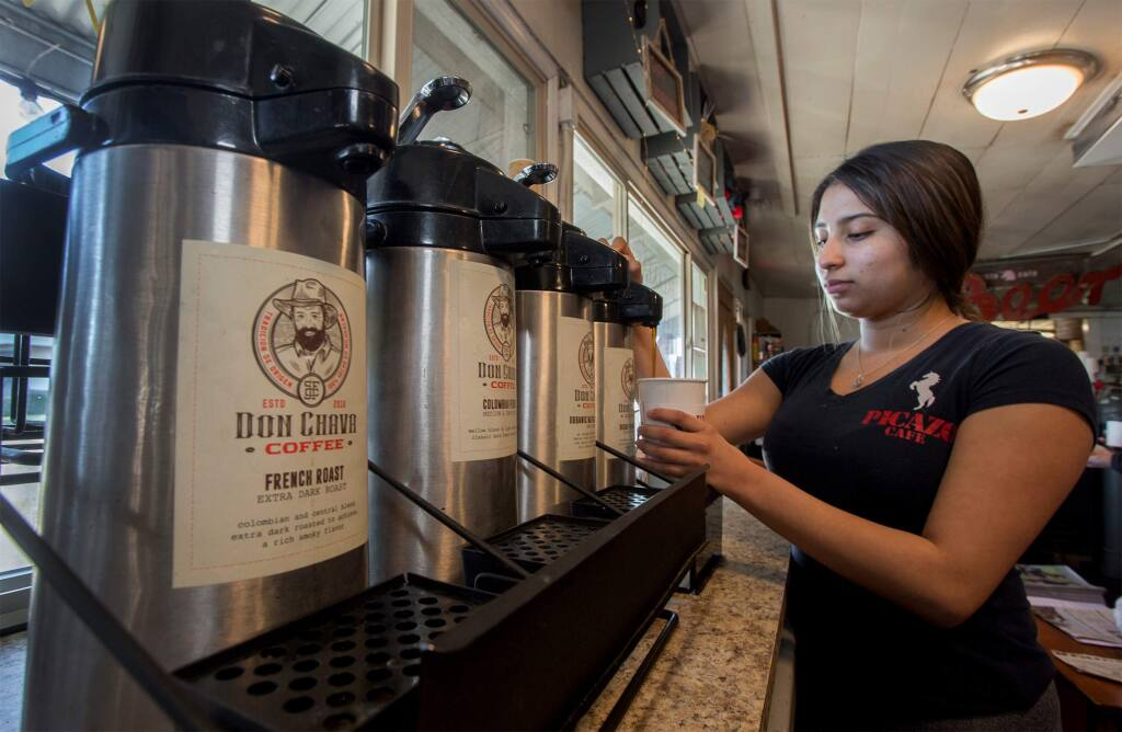 Server Brianda Prudente pours a cup of Don Chava coffee, now available at the Picazo Cafe. (Photo by Robbi Pengelly/Index-Tribune)