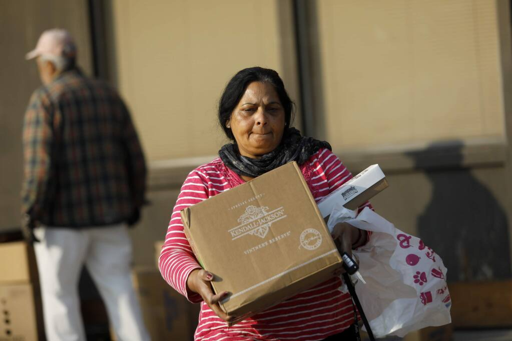 In-home caregiver Suki Badhan picks up groceries from the Redwood Empire Food Bank for her client at the Rohnert Park Senior Center in Rohnert Park on Wednesday, November 14, 2018. (BETH SCHLANKER/ The Press Democrat)