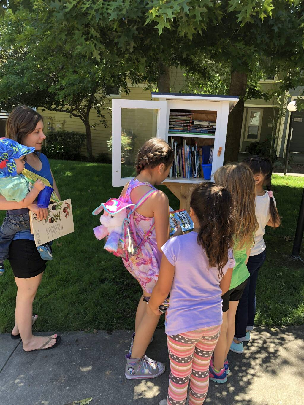 A Little Free Library was installed at the Madrone housing complex in Petaluma to promote literacy. ERIN HAWKINS FOR THE ARGUS-COURIER
