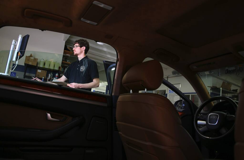 Service Consultant Marc Brady runs a diagnostics test on a vehicle at Hammond Autowerks in Santa Rosa on Thursday, March 2, 2017. Brady is a graduate of the SRJC automotive training program.(Christopher Chung/ The Press Democrat)