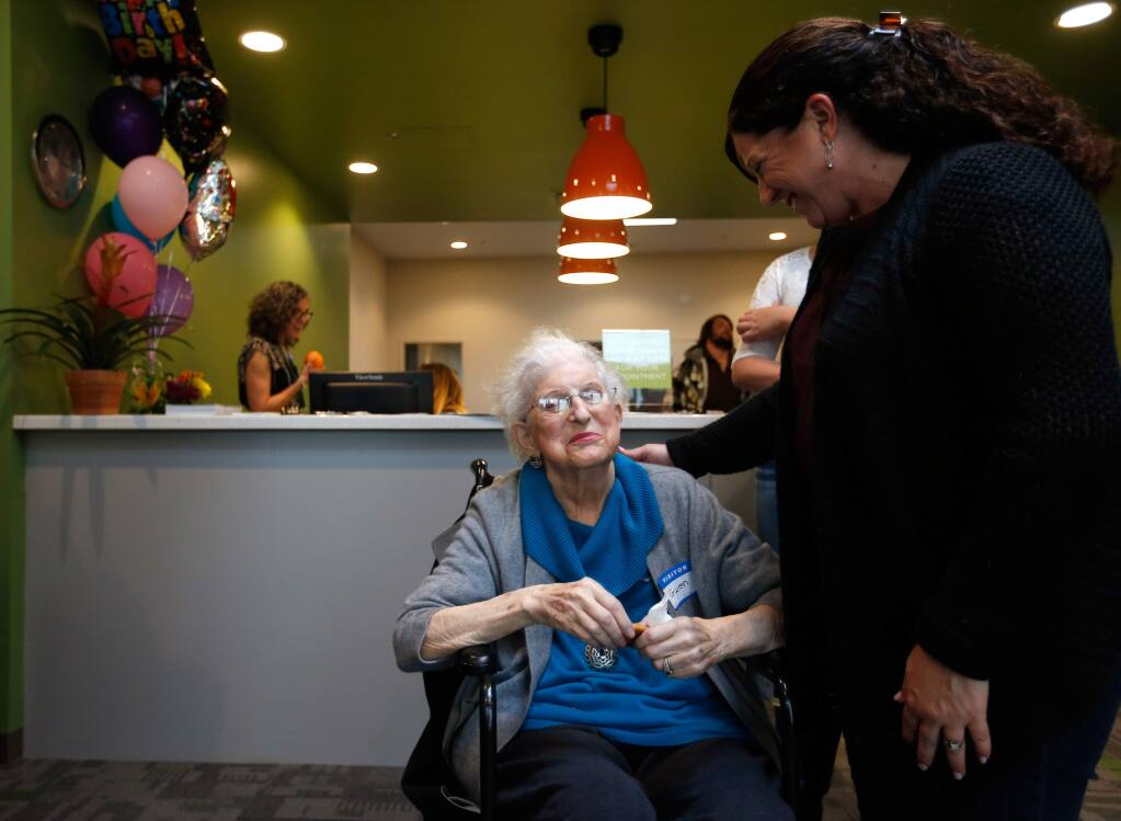 Spring Lake Village resident Gwen Zeller, left, who led the Dream Center fundraising efforts at the senior community, talks with her daughter, Jackie Avila, after a courtyard was dedicated to Spring Lake Village residents at the SAY Dream Center in Santa Rosa on Wednesday, Feb. 17, 2016. Residents of the Spring Lake Village senior community were the largest group of organized supporters and first financial donors to the SAY Dream Center. (Alvin Jornada / The Press Democrat)