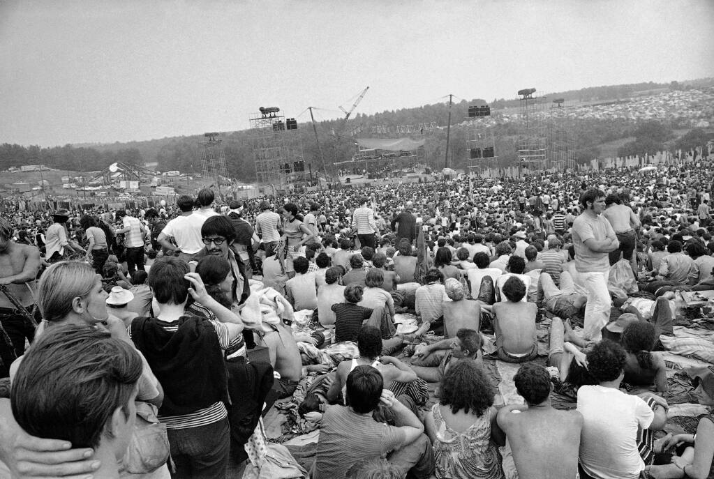 FILE - This Aug. 14, 1969 file photo shows a portion of the 400,000 concert goers who attended the Woodstock Music and Arts Festival held on a 600-acre pasture near Bethel, N.Y. For the first time, an audio recording is available of nearly everything heard onstage at Woodstock 50 years ago - from transcendent music to announcements about lost people and bad acid. It's the entire Woodstock experience, minus the mud. A 38-disc package 'Woodstock - Back to the Garden - The Definitive Anniversary Archive' is available now. (AP Photo/File)