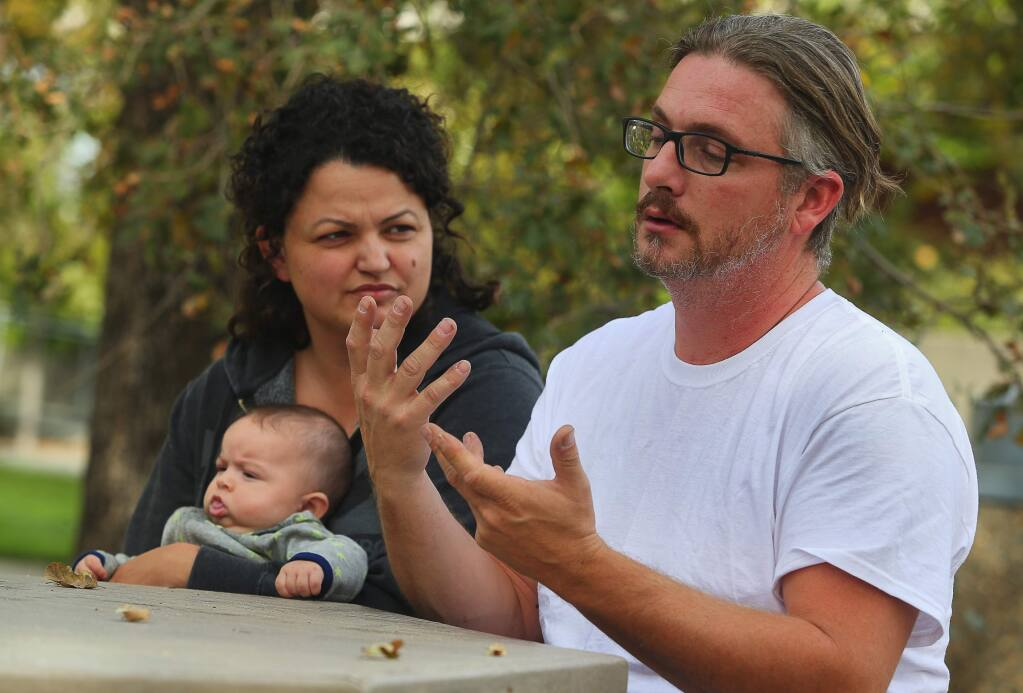 Deaf couple Doug Fischer and Destiny Castellanos, with their three-month-old baby Stone Fischer, recount their escape from their Coffey Park home, with their two daughters. The home they were renting was completely destroyed. (Christopher Chung/ The Press Democrat)