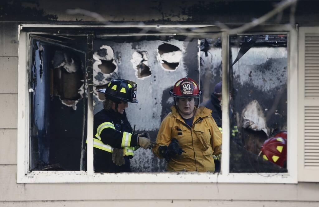 Fire investigators Devon Gambonini, right, and Cyndi Foreman, left, at scene of fatal fire on Wednesday, Feb. 20, 2019. (Beth Schlanker / The Press Democrat)