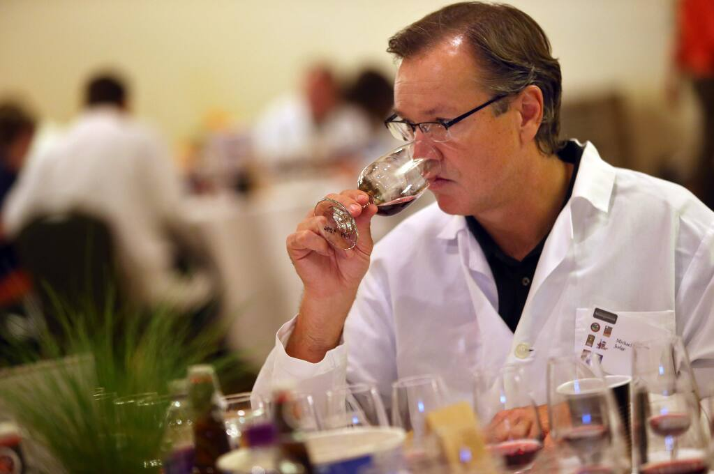 Michael Scholz samples a wine during the 2014 North Coast Wine Challenge. (Christopher Chung/ PD FILE)