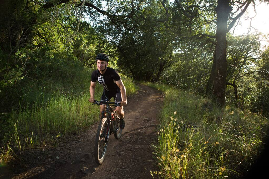 Charlie Gesell / For The Press DemocratTorah Soltani, owner of Mac's Deli, rides Marsh Trail in Annadel State Park on May 27.