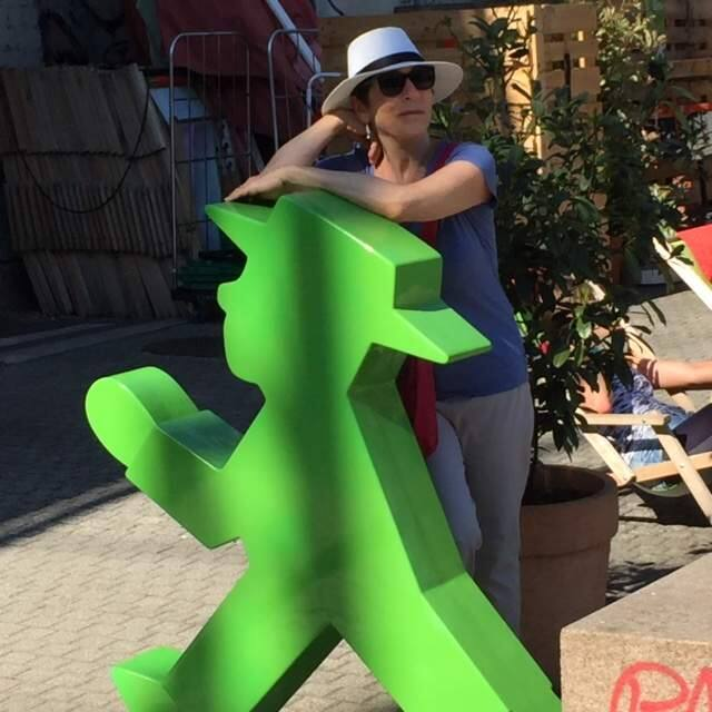Writer Joan Frank with Ampelmanchen, the Little Traffic Light Man, in Germany. (Robert Duxbury)