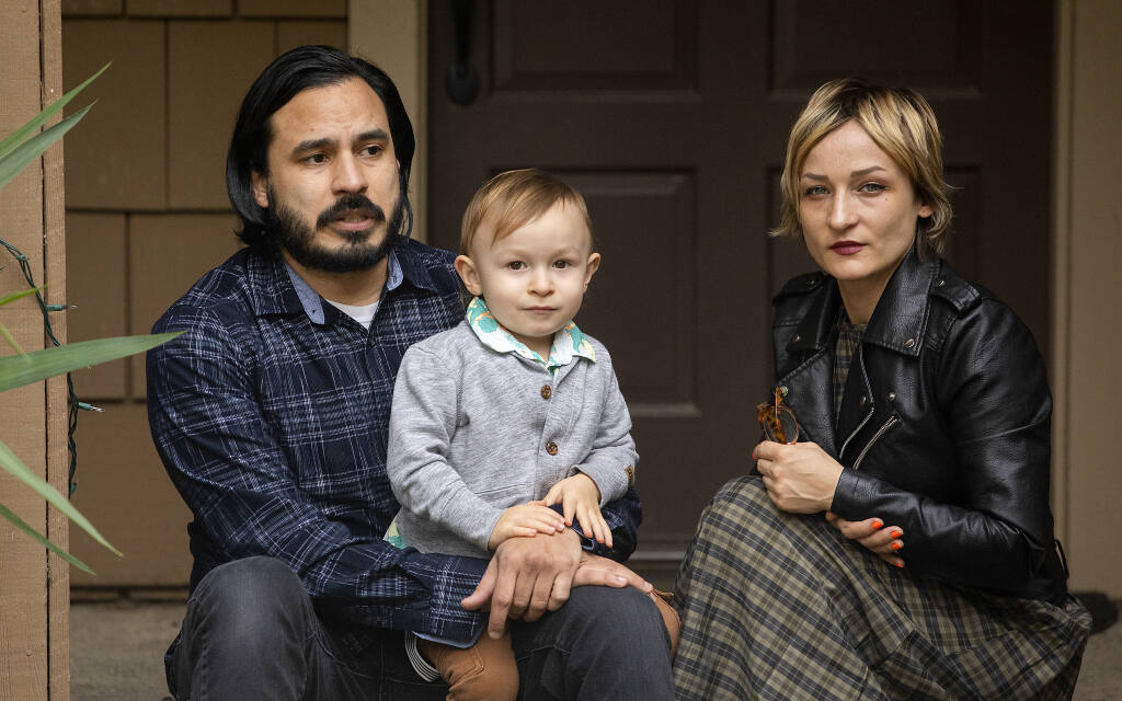 Ian Velasquez, his partner Amy Sprague and their son Neveo, 2, are nearly $17,000 behind in the rent on their Sebastopol home after roommates lost their jobs and had to move out at the beginning of the pandemic. More than 1 million California rental households face an estimate $3.7 billion rental debt. (John Burgess/The Press Democrat)