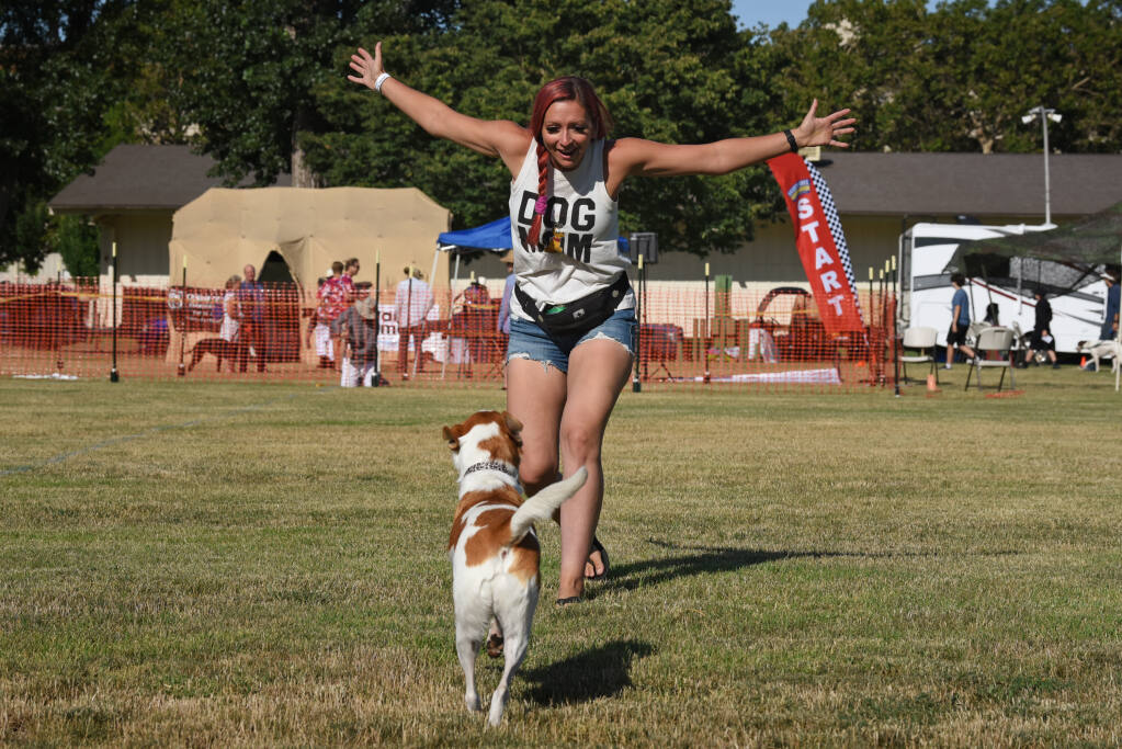 Tyree Hand getting her dog Marilyn excited about their day at the Wine Country Canine Fun Run held at the Sonoma County Fairgrounds in Santa Rosa, Calif. on Saturday, July 10, 2021. (Photo: Erik Castro/for The Press Democrat)