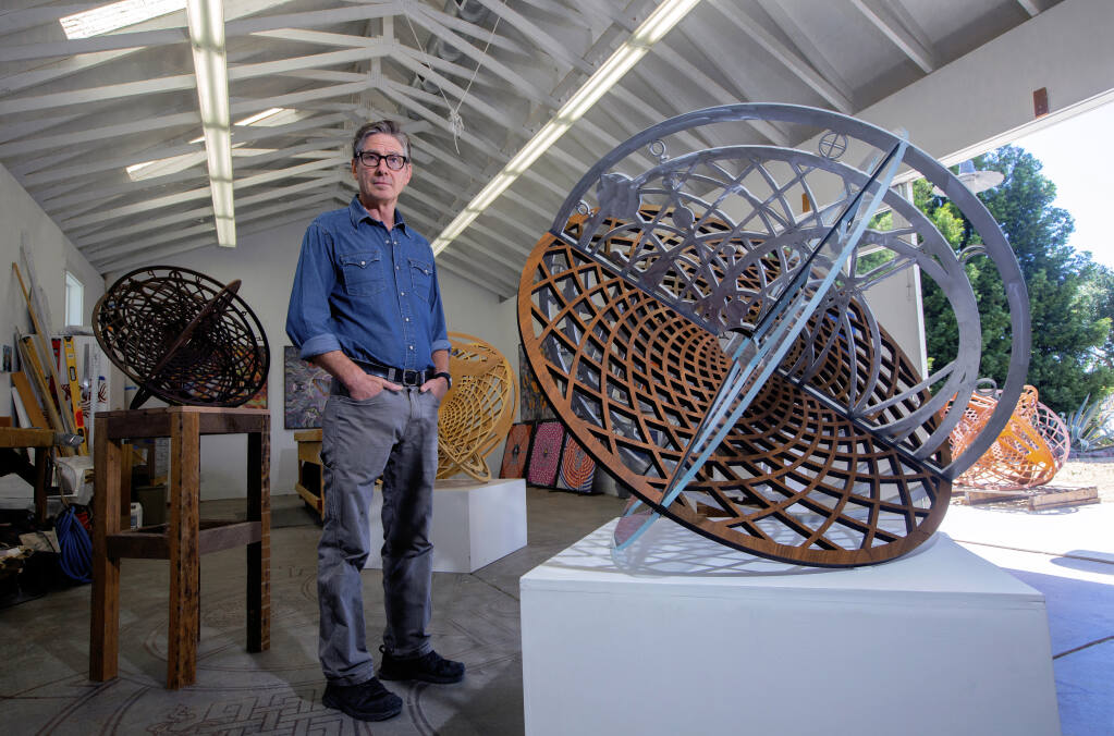 Artist Peter Hassen with a few of his metal sculptures in his Sonoma studio on Wednesday, June 23, 2021. (Photo by Robbi Pengelly)