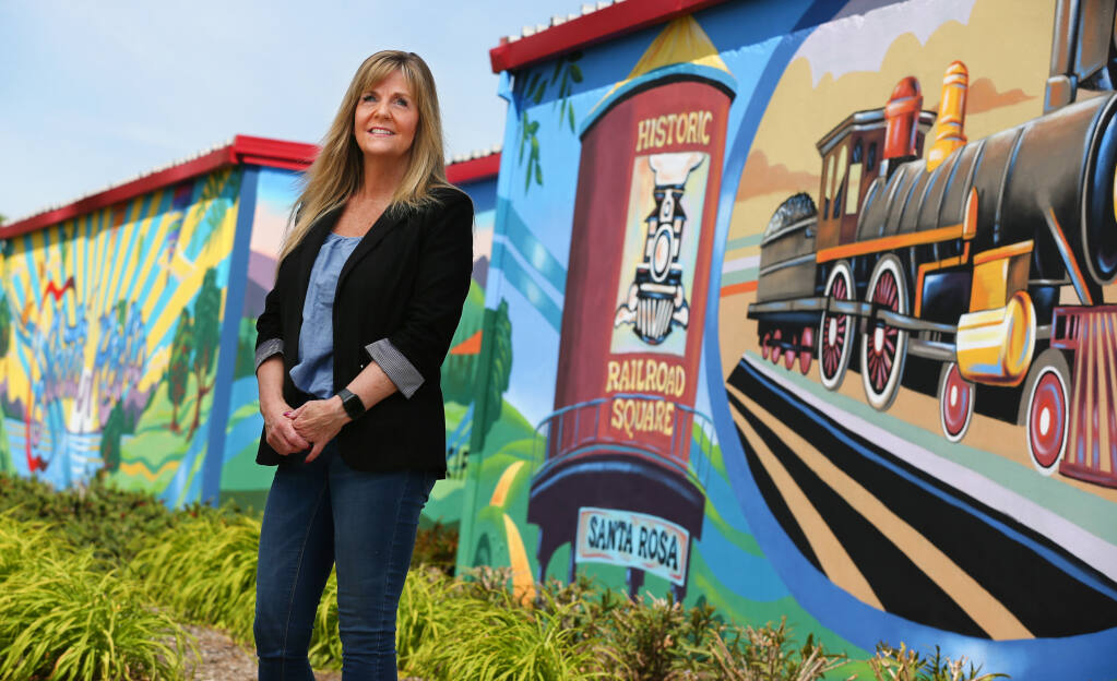 Terri Hemenes is the office manager at Security Public Storage, where murals by artist Jerry Ragg provide a colorful welcome to the Coffey Park area of Santa Rosa.  (Christopher Chung/ The Press Democrat)