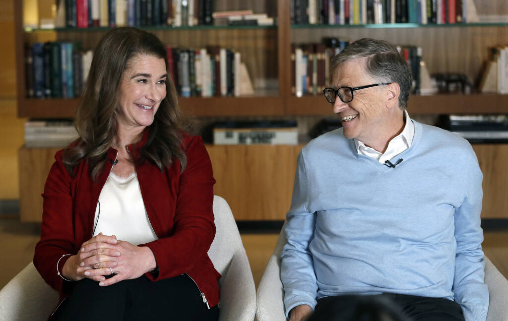 FILE--In this Feb. 1, 2019, file photo, Bill and Melinda Gates look toward each other and smile while being interviewed in Kirkland, Wash.   (AP Photo/Elaine Thompson, File)