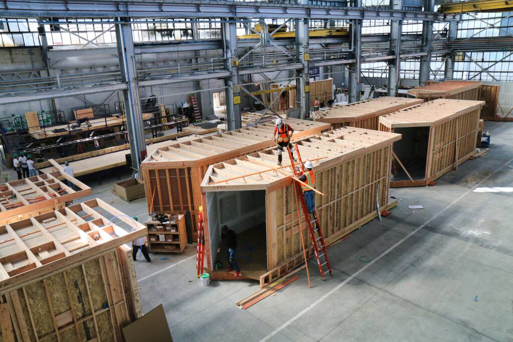 """Factory_OS's main plant on Mare Island in Vallejo, seen here on Tuesday, Oct. 20, 2020, and its new facility next door are expected to turn out about 2,000 modules like this annually. Each """"box"""" can accommodate housing units of 300–1,000 square feet, with larger units possible via multiple modules. (Jeff Quackenbush / North Bay Business Journal)"""