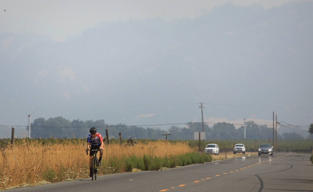 The Mayacamas Mountains above Alexander Valley are barely visible due the smoke from numerous wildfires in the region, Monday, Aug. 31, 2020 in Healdsburg.  (Kent Porter / The Press Democrat)