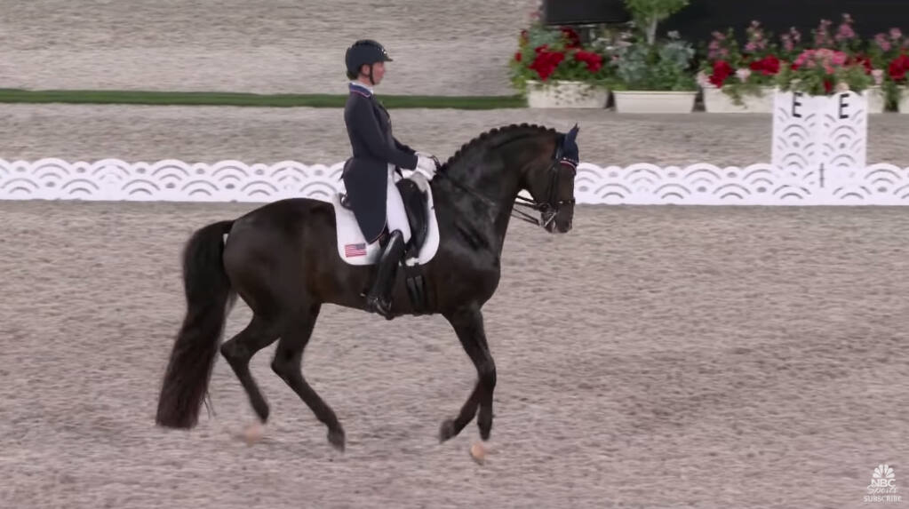 In this screenshot from a video, Sabine Schut-Cary competes in team dressage at the Tokyo Olympics. (NBC Sports/YouTube)
