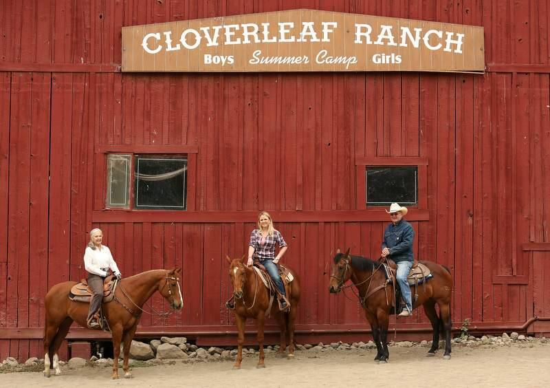 Shawna DeGrange, center, on Bill, with her parents Ginger DeGrange, left, on Hank and Ron DeGrange, right, on Arnie, at Cloverleaf Ranch in Santa Rosa, Wednesday, May 8, 2013. (Crista Jeremiason / The Press Democrat)