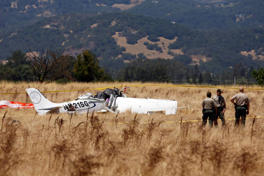 Sonoma County Sheriff's Deputies secure a perimeter around the site of a fatal airplane crash near Schellville, California on Thursday, July 13, 2017. (Alvin Jornada / The Press Democrat)