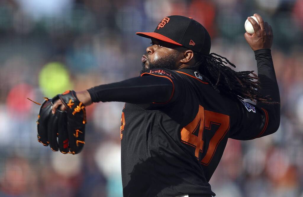 In this July 28, 2018, file photo, San Francisco Giants pitcher Johnny Cueto works against the Milwaukee Brewers in the first inning in San Francisco. Cueto is scheduled to throw next week for the first time since undergoing Tommy John reconstructive surgery in August. (AP Photo/Ben Margot, File)