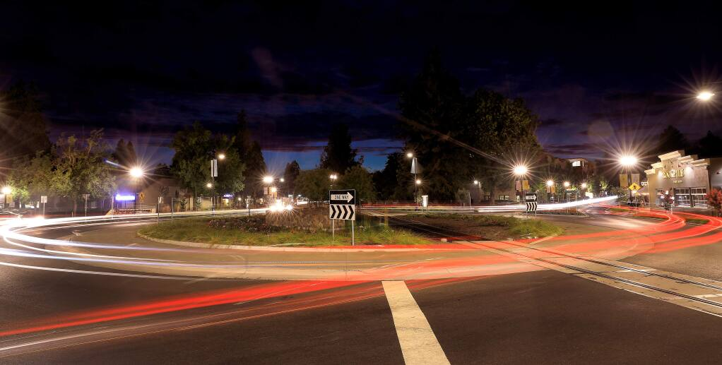A long-exposure photograph captures headlights and taillights at the Healdsburg roundabout on Monday, Aug. 5, 2019. (KENT PORTER/ PD)