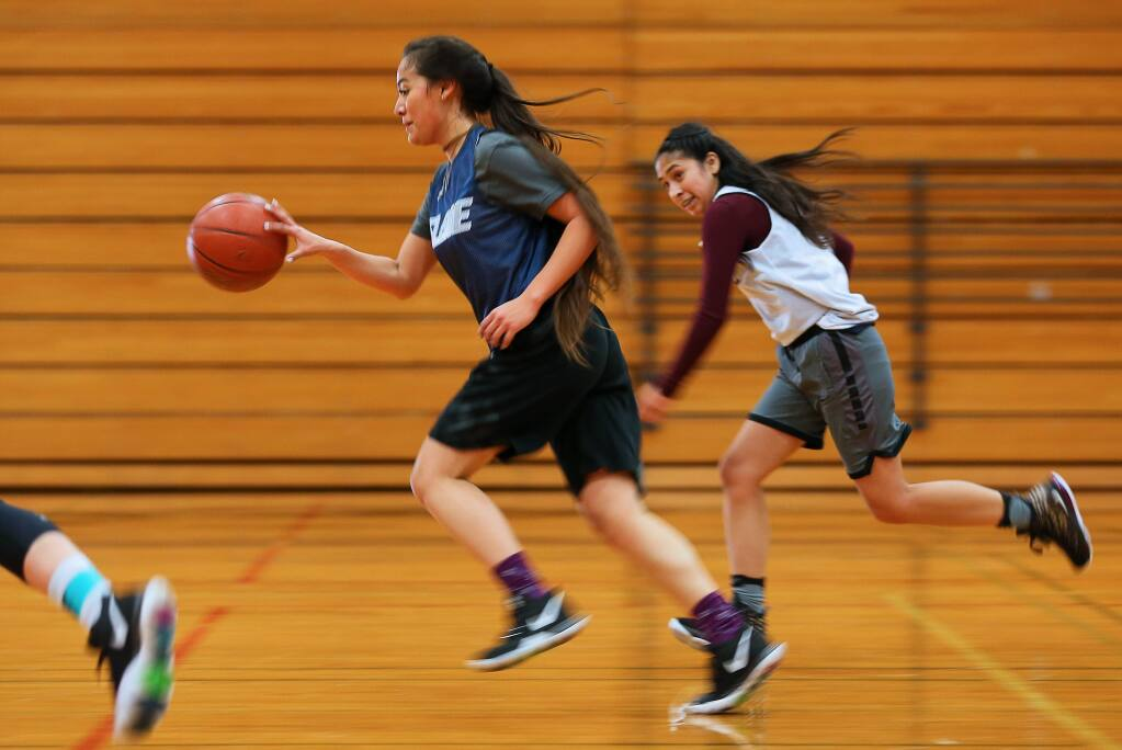 Elsie Allen's Samantha Holguin leads a fast break during practice in Santa Rosa on Monday, January 6, 2020. (Christopher Chung / The Press Democrat)