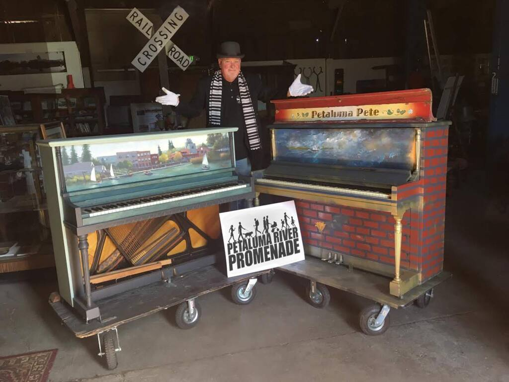 Brenda L. Maher John Maher shows off a piano, at left, painted by Nancy Lloyd that will be on display in the Petaluma Textile & Design window, and one painted by Evelyn Dolowitz Nitzberg that is earmarked for the Blush beauty boutique showroom window.