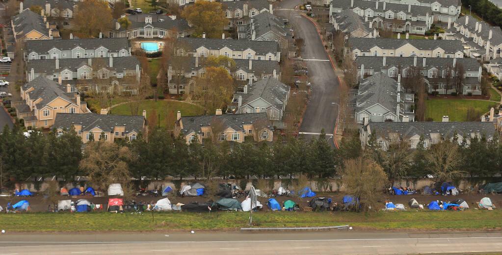 The homeless encampment along Joe Rodota Trail fronts the Casa del Sol townhouse complex, Tuesday, Jan. 14, 2020 in Santa Rosa.  (Kent Porter / The Press Democrat) 2020