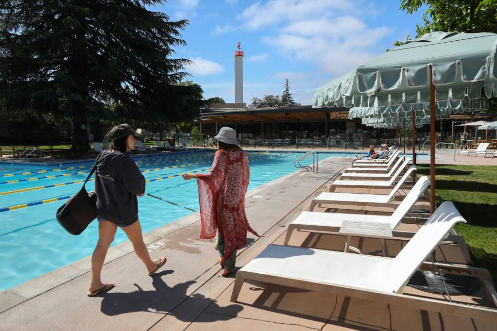 Sofia and Amy Cirincione walk along the pool deck at the Flamingo Resort in Santa Rosa on Thursday, May 13, 2021.  (Christopher Chung/ The Press Democrat)