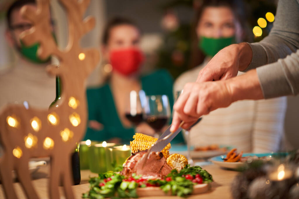 If you must, enjoy a small holiday gathering with appropriate health precautions, advise Bay Area health officers. (Kamil Macniak/Shutterstock)