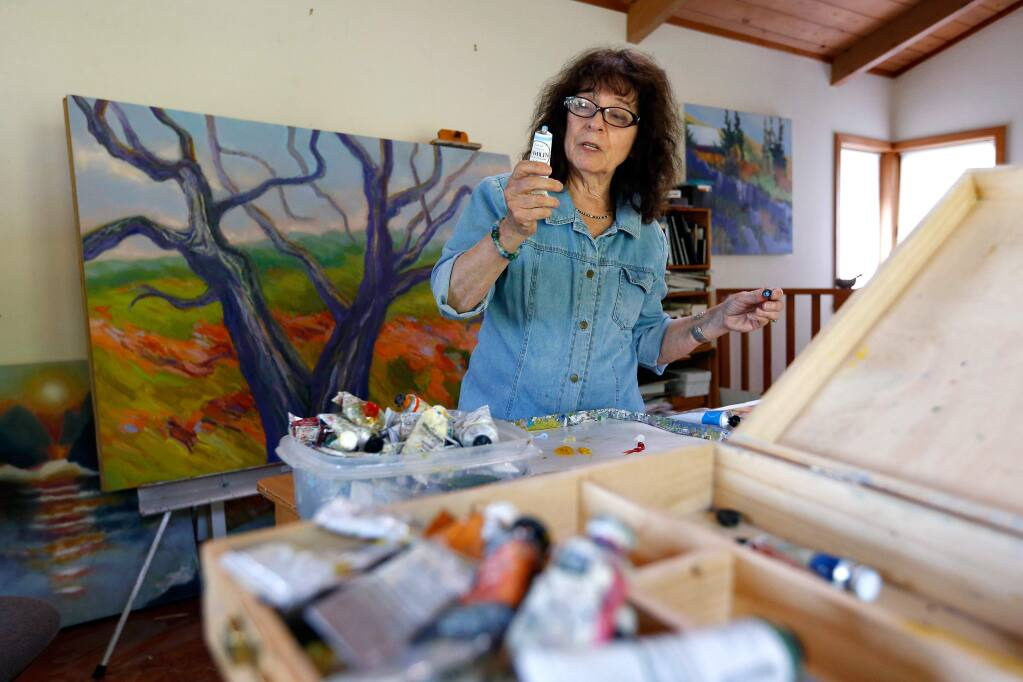 Artist Marsha Connell chooses colors as she continues work on a Giving Tree painting for the Jewish Community Free Clinic at her studio in Santa Rosa, California, on Thursday, May 19, 2016. (Alvin Jornada / The Press Democrat)