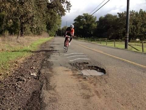 A cyclist negotiates a pothole on one of Sonoma Countys crumbling roads. (SUBMITTED BY CRAIG HARRISON)
