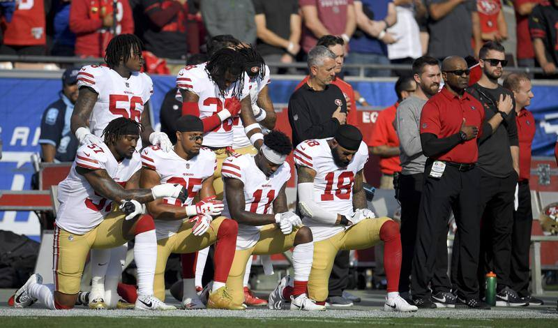 Members of the San Francisco 49ers kneel during the national anthem before a game against the Los Angeles Rams Sunday, Dec. 31, 2017, in Los Angeles. (AP Photo/Mark J. Terrill)