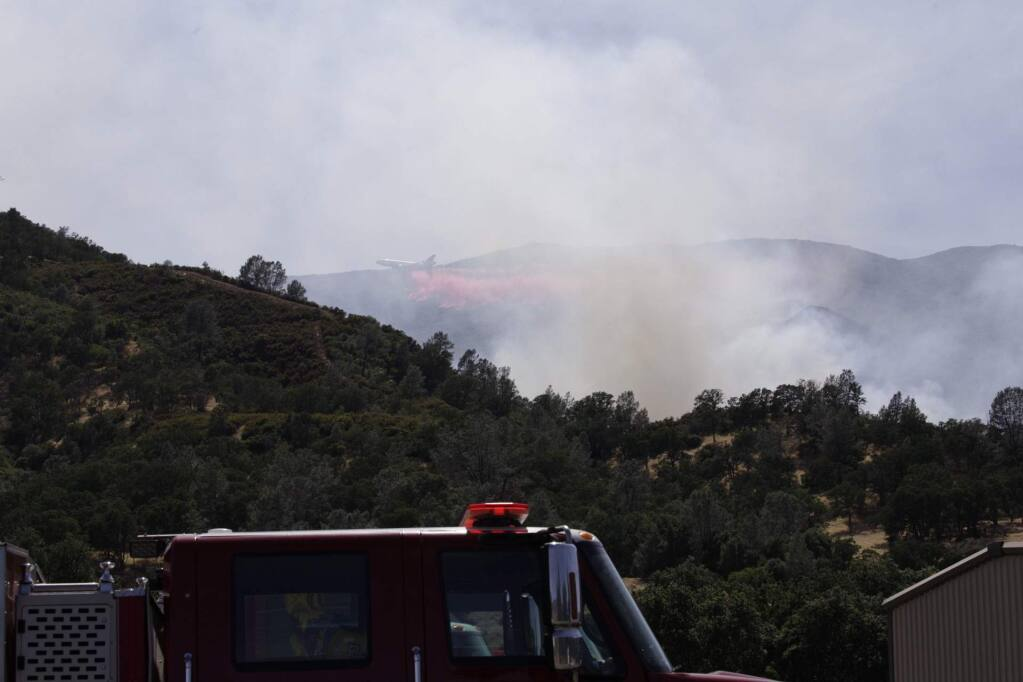 A tanker drops fire retardant on the Sand fire in Yolo County near Rumsey, California after 3 p.m. on Sunday, June 9, 2019. (CRAIG PHILPOTT)
