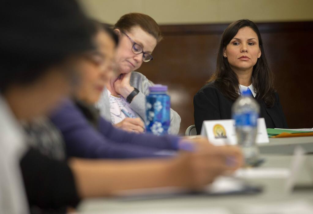 Karlene Navarro, right, the director of the Sonoma County Independent Office of Law Enforcement Review and Outreach (IOLERO), attends a Community Advisory Council meeting in Windsor on Monday, May 6, 2019. (John Burgess / The Press Democrat)
