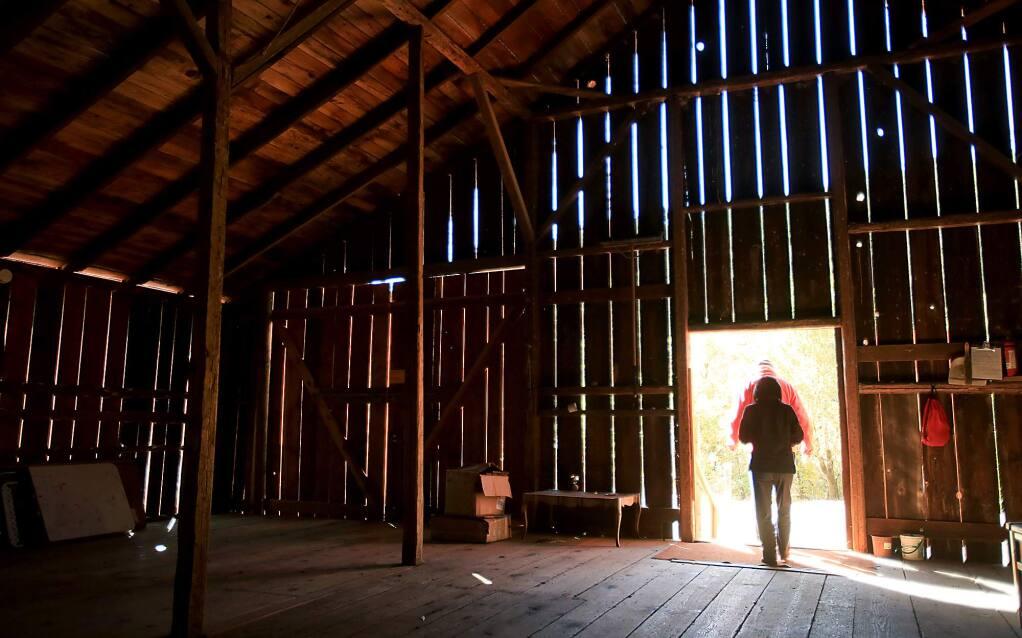 Betty and Jim Doerksen of Rancho Mark West, exit Sonoma County's oldest barn, Monday Oct. 26, 2015 in Santa Rosa. (Kent Porter / Press Democrat) 2015