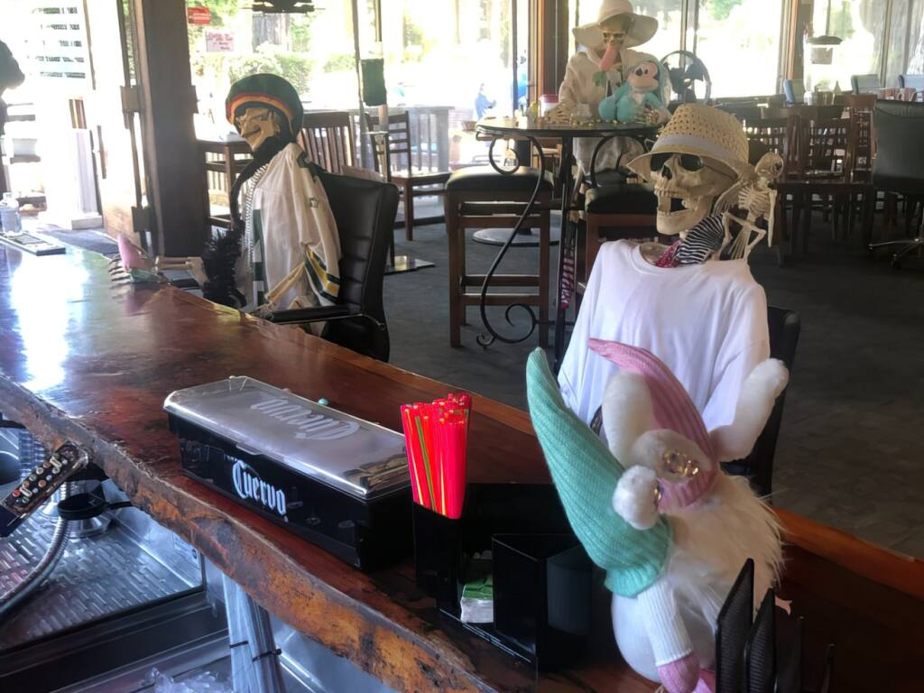 Two skeletons sit at the bar at Northwood Restaurant in Monte Rio. (Northwood Restaurant/Facebook)