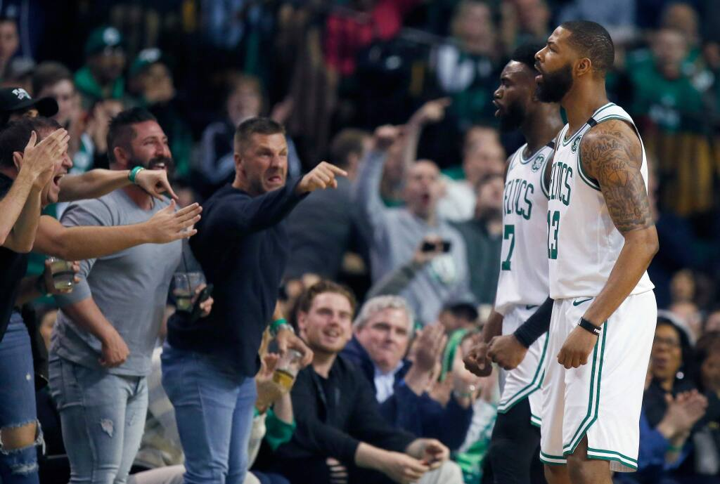 Fans react after Boston Celtics' Marcus Morris (13) was fouled while shooting during the first quarter of Game 1 of a first-round playoff series against the Milwaukee Bucks, in Boston, Sunday, April 15, 2018. (AP Photo/Michael Dwyer)