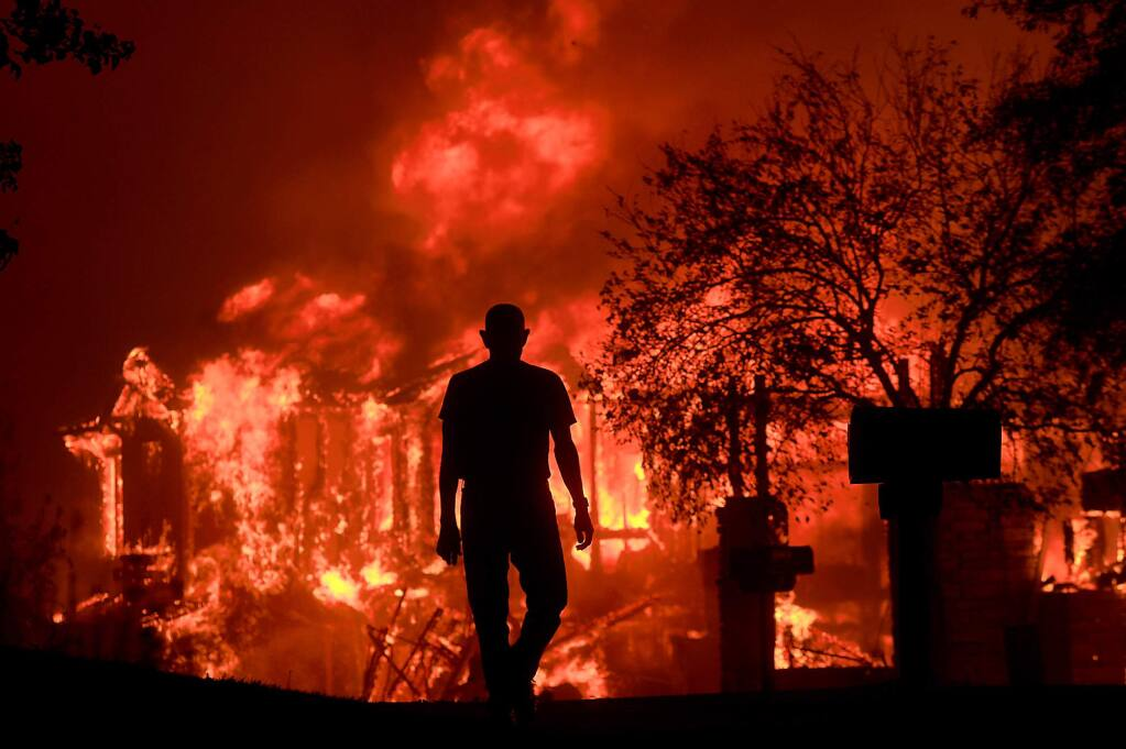 Bill Stites watches his Fountaingrove neighborhood burn in Santa Rosa on Monday, Oct. 9, 2017. (KENT PORTER/ PD)