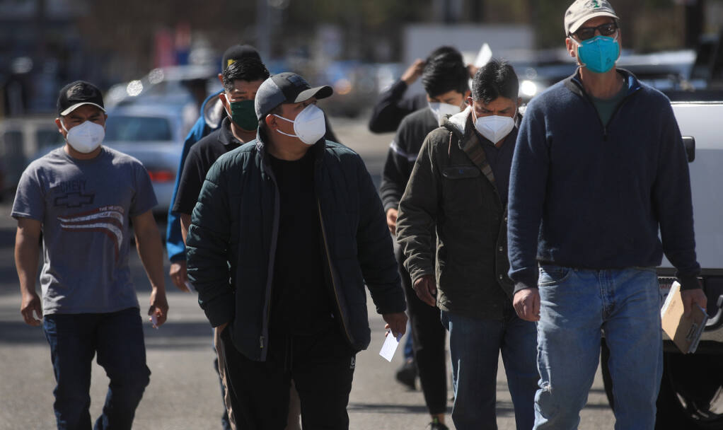 A group of farmworkers from Peay Vineyard of Annapolis arrive at the Sonoma County Fairgrounds in Santa Rosa, Friday, March 19, 2021 to get their second Moderna vaccine. (Kent Porter / The Press Democrat) 2021