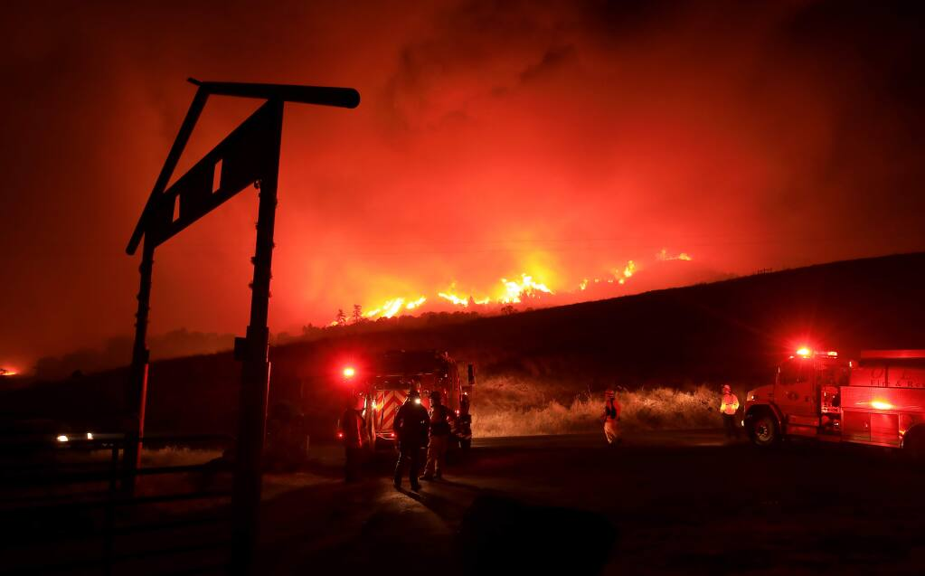 Firefighters prepare to defend their ground as the Kincade fire marches down Black Mountain toward Hawkeye Ranch in The Geysers on Thursday, Oct. 24, 2019. (KENT PORTER/ PD)