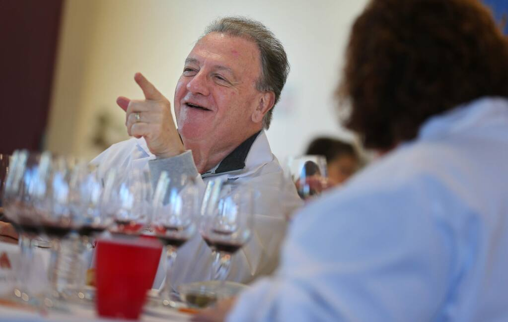 Charles Mara tries to convince a fellow wine judge to move his award for a wine up from silver to gold during the Sonoma County Harvest Fair Wine Competition, in Santa Rosa on Tuesday, September 17, 2019. (Christopher Chung/ The Press Democrat)