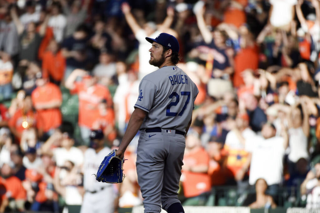 Los Angeles Dodgers starting pitcher Trevor Bauer watches the solo home run of the Houston Astros' Jose Altuve during the first inning on Wednesday, May 26, 2021, in Houston. (Eric Christian Smith / ASSOCIATED PRESS)