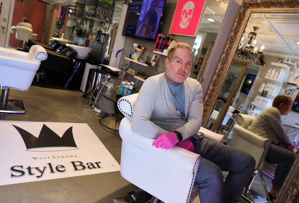 Berlin Fisher, owner of West Sonoma Style Bar in Guerneville, has business interruption insurance coverage because of the public safety power shutoffs, but is finding that the policy is excluding virus pandemics because there is no property damage.(Christopher Chung/ The Press Democrat)