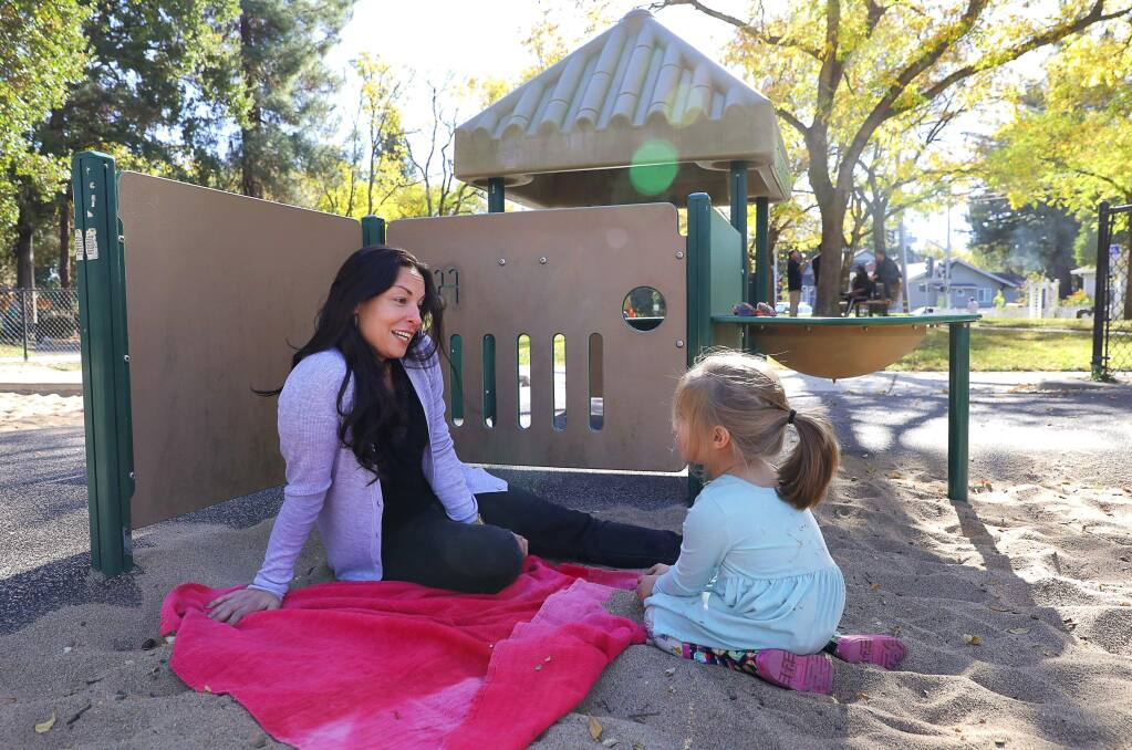 Santa Rosa City Council member Victoria Fleming plays with her daughter, Evie, at Humboldt Park in Santa Rosa on Wednesday, Nov. 7, 2018. (Christopher Chung / The Press Democrat, 2018)