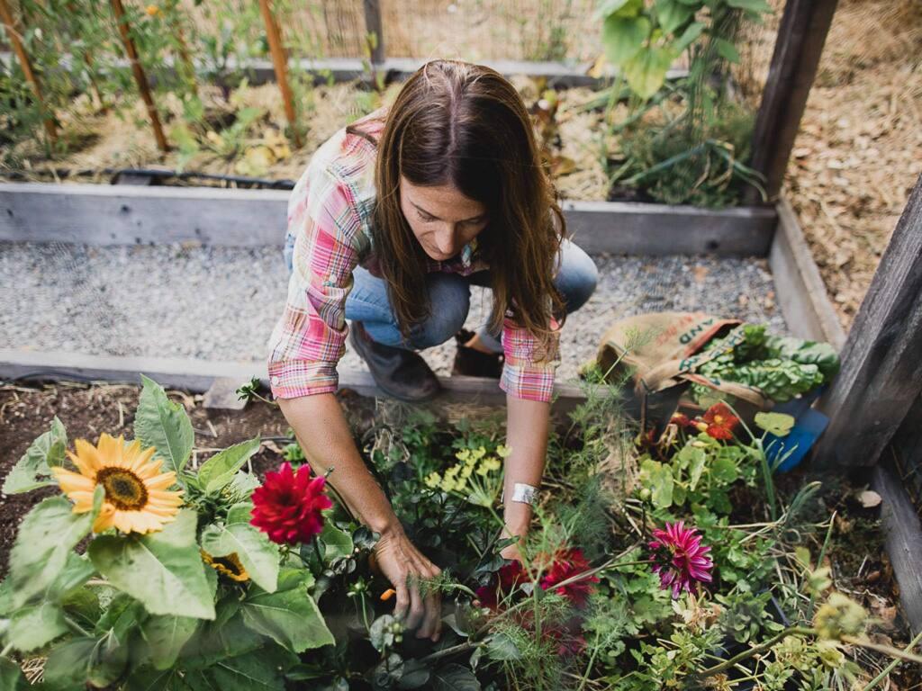 Garden designer and teacher Emily Murphy of Mill Valley harvests flowers in her garden. (West Cliff Creative)