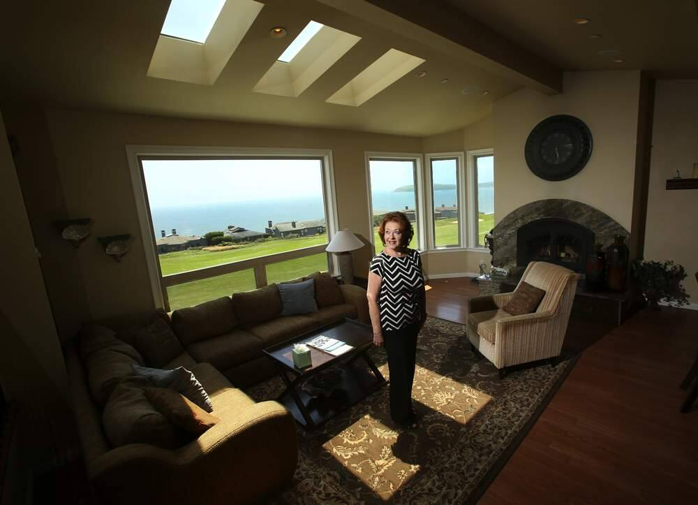 Thera Buttaro with Bodega Bay & Beyond vacation home rentals inside one of the homes she offers for rent in Bodega Harbour. (photo by John Burgess/The Press Democrat)