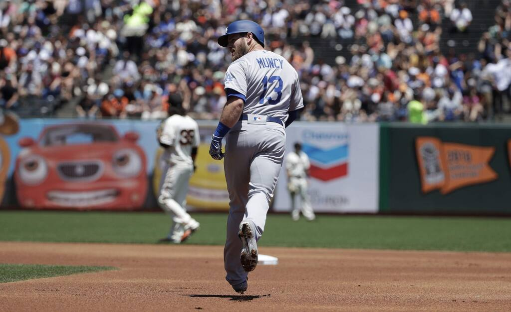 Los Angeles Dodgers' Max Muncy rounds the bases after hitting a solo home run off of San Francisco Giants pitcher Madison Bumgarner during the first inning of a baseball game in San Francisco, Sunday, June 9, 2019. (AP Photo/Jeff Chiu)