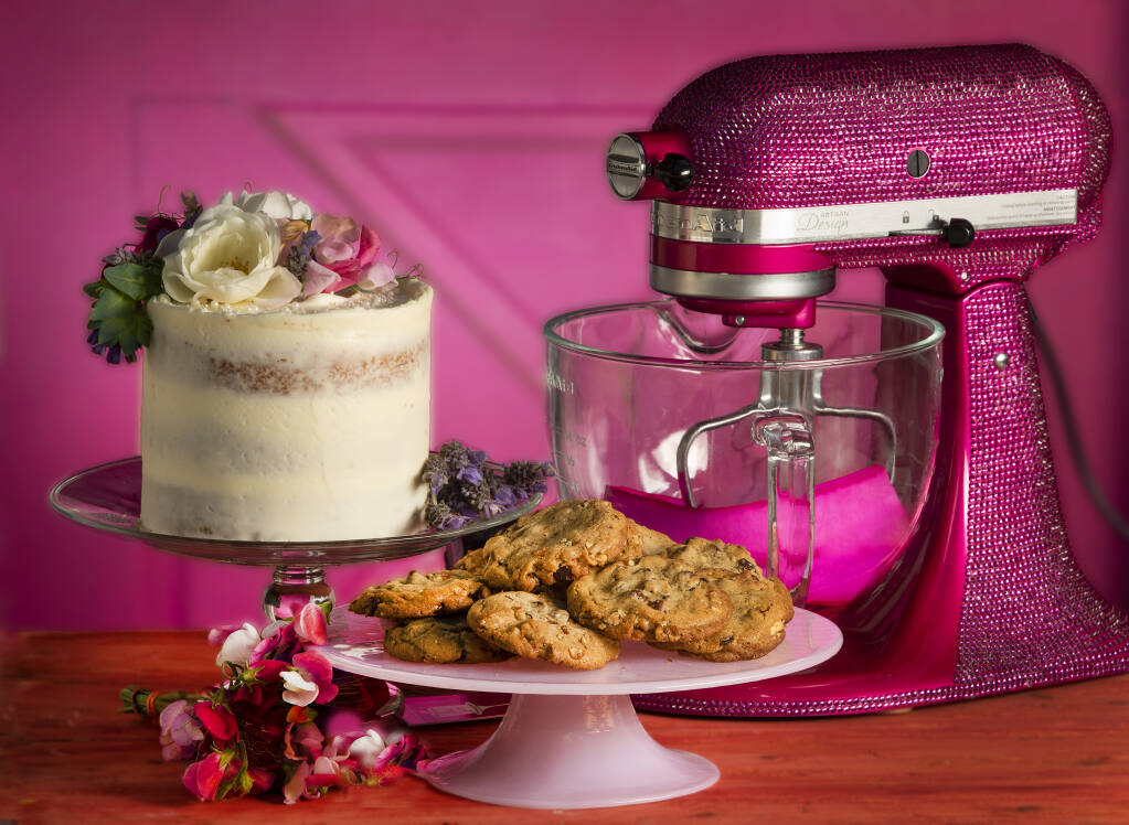 Lady Grey Cake with Earl Grey tea and a lavender buttercream, decorated with fresh flowers, left; and Bourbon Brown Butter Chocolate Chip Cookies with Pecans from Cloverdale Flour Girl Shannon Moore.  (John Burgess/The Press Democrat)