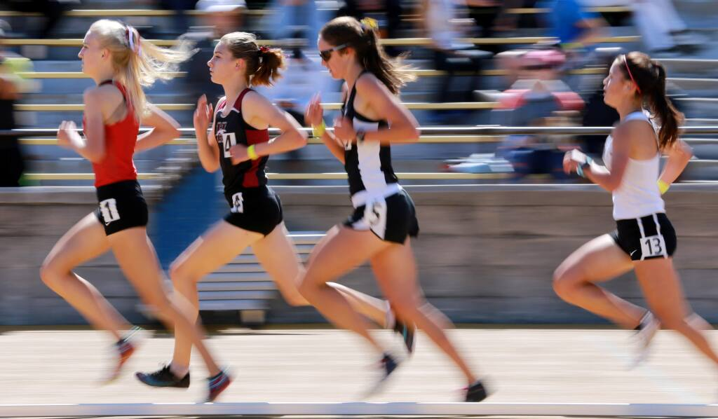 Gabrielle Peterson of Healdsburg, second from left, trails Kelli Wilson of Monte Vista in the girls' 3,200-meter run during the track and field NCS Meet of Champions, at UC Berkeley's Edwards Stadium, on Saturday, May 26, 2018. (Photo by Darryl Bush / For The Press Democrat)