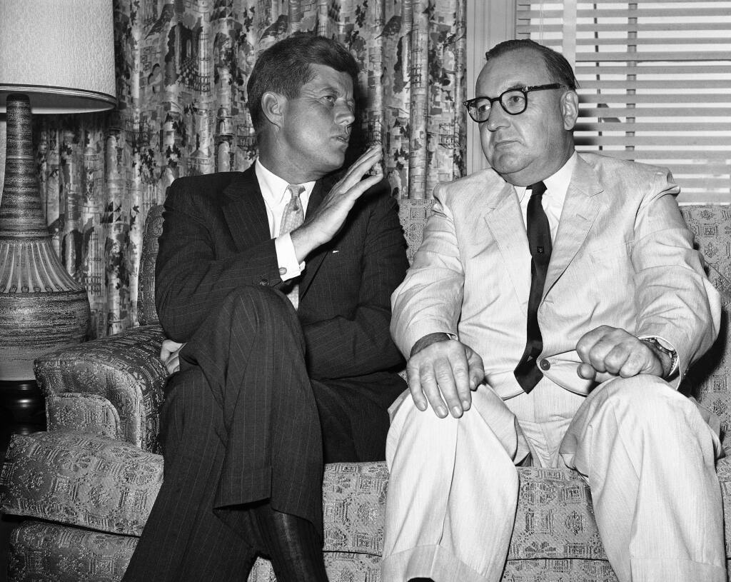 FILE - In this July 10, 1960, file photo, Sen. John F. Kennedy of Massachusetts gestures during his meeting with California Gov. Edmund G. (Pat) Brown in Los Angeles. Former California Gov. Jerry Brown wants to know who is trying to sell his father's memorabilia related to the assassination of President John F. Kennedy. Private letters and other items that had belonged to Edmund G. 'Pat' Brown when he was California governor are being offered by the auction house Sotheby's, which estimates the value at $20,000 to $30,000. (AP Photo, File)