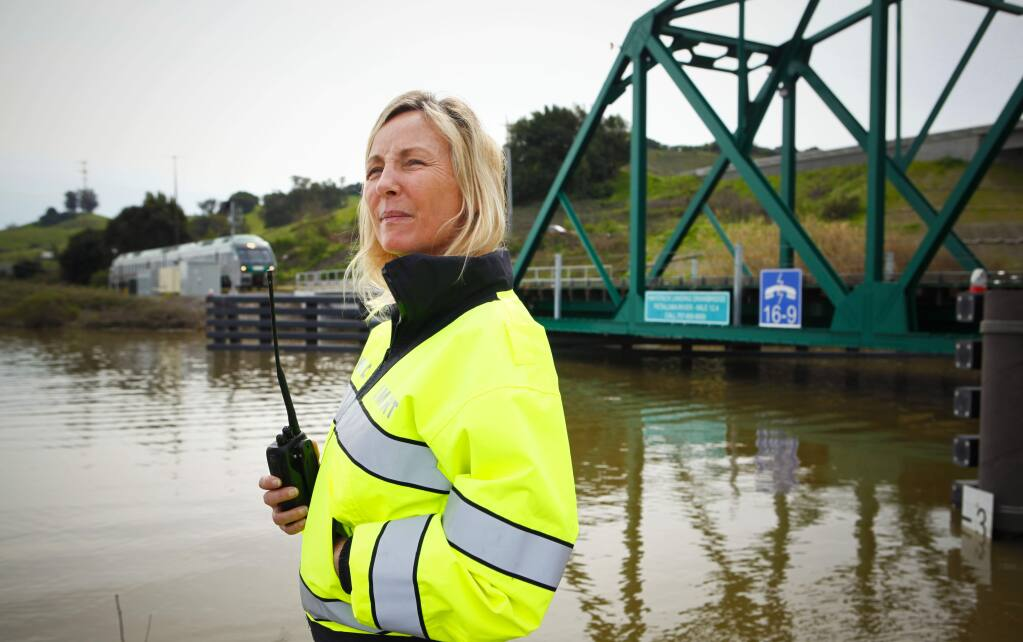 Petaluma, CA, USA. Friday, March 10, 2017._ Cathy Howell is in charge of raising and lowering the bridge where the SMART train crosses the Petaluma River.(CRISSY PASCUAL/ARGUS-COURIER STAFF)